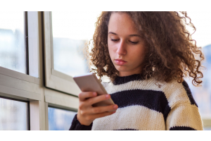 Teen Looking at Phone
